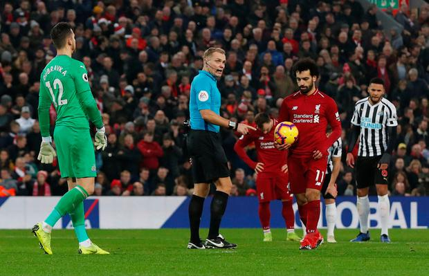 Liverpool's Mohamed Salah prepares to take a penalty