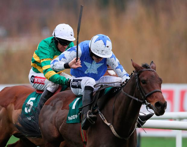 Aramon ridden by Ruby Walsh (right) races clear of the last on the way to winning the Paddy Power Future Champions Novice Hurdle during day two of the Leopardstown Christmas Festival at Leopardstown Racecourse. Photo. Brian Lawless/PA Wire