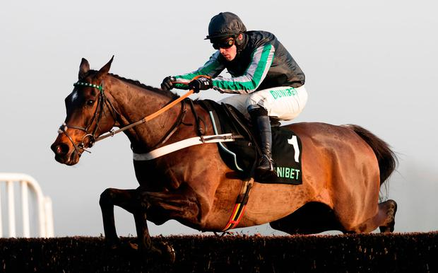Altior ridden by Nico de Boinville jumps the last on the way to winning The Unibet Desert Orchid Chase at Kempton Park. Photo: John Walton/PA