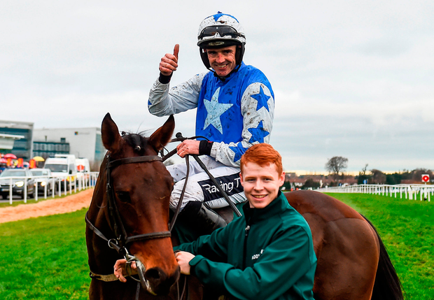 One for the Future: Ruby Walsh celebrates aboard Aramon after winning the Paddy Power Future Champions Novice Hurdle, along with the horse's groom Justin Hannafin. Photo: Eóin Noonan/Sportsfile