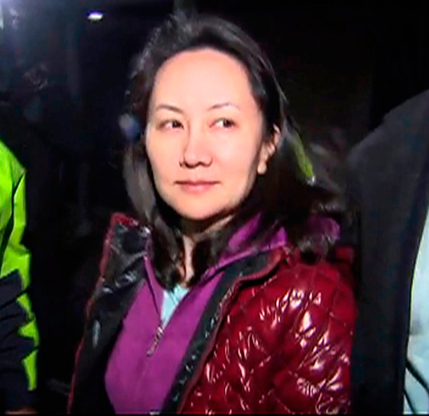 Huawei row: A TV image of Huawei Technologies' CFO Meng Wanzhou as she exits the court registry following a bail hearing at British Columbia Superior Courts in Vancouver