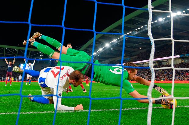 Bernd Leno saves the ball on the goal line in front of Glenn Murray on what proved to be an afternoon of frustration for Arsenal. Photo: Mike Hewitt/Getty Images