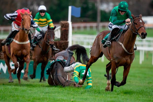 Simply too good: Simply Ned (left) sets off in pursuit of Footpad after jumping the last fence before catching Ruby Walsh's mount in the final strides to produce a shock victory at Leopardstown yesterday. Photo: INPHO/Morgan Treacy