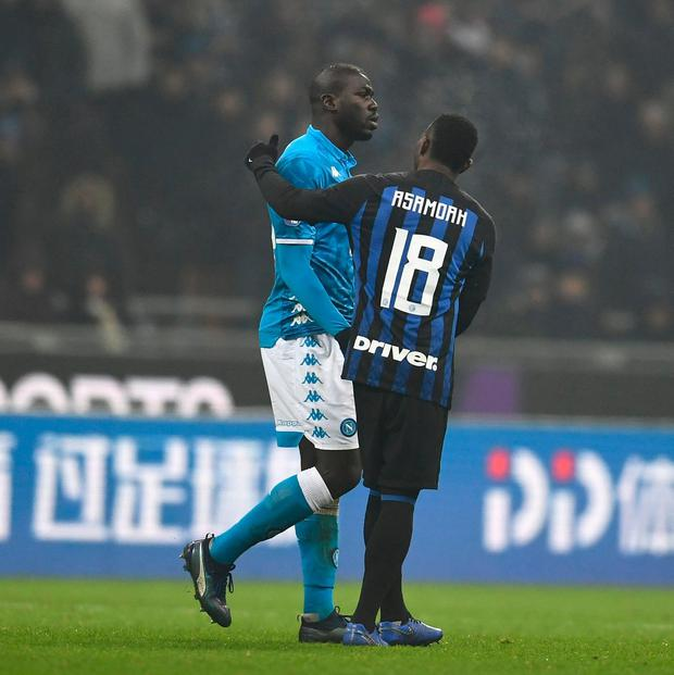 Napoli's Kalidou Koulibaly is consoled by Inter Milan's Kwadwo Asamoah after being sent off at the San Siro. Photo: Claudio Villa - Inter/Inter via Getty Images
