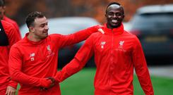 Xherdan Shaqiri and Sadio Mane in relaxed mood yesterday during Liverpool training at Melwood. Photo: John Powell/Liverpool FC via Getty Images