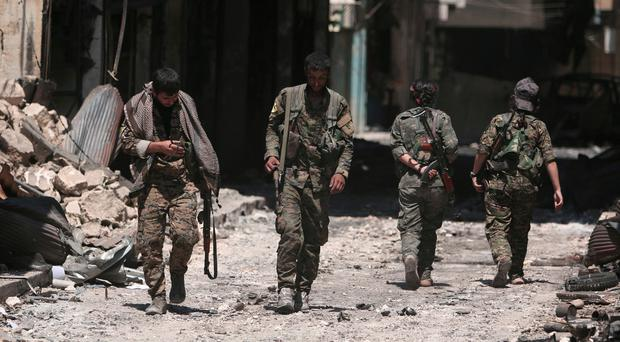 Syrian troops enter flashpoint town after Turkey threatens offensive