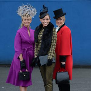 Winner Carita Conway, centre, 2nd place Emer Kilroy, left , and 3rd place Paula McCormack, right, from at the best dressed ladies competition at the Christmas Racing Festival - Limerick Racecourse Picture: Caroline Quinn