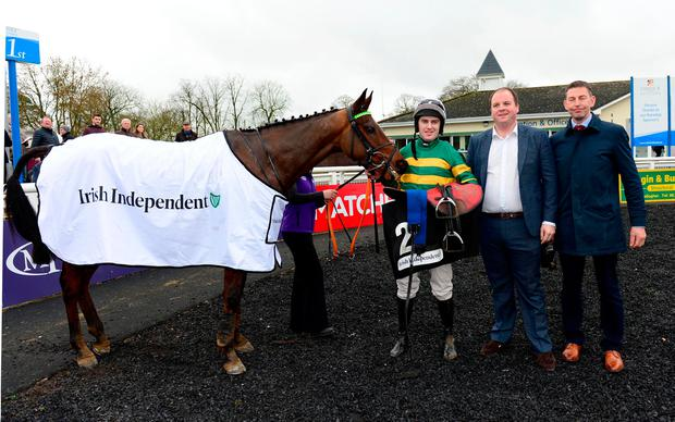 Padraig Coakley of the Irish Independent (centre) with jockey Jody McGarvey and trainer Gavin Cromwell after Espoir D'Allen's victory in the Irish Independent Hurdle at Limerick. Photo: Healy Racing