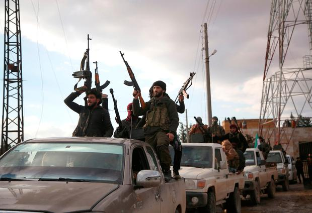 Turkish-backed Syrian rebels gather in Sajour amid rumours of an offensive on the nearby town of Manbij. Photo: Getty Images