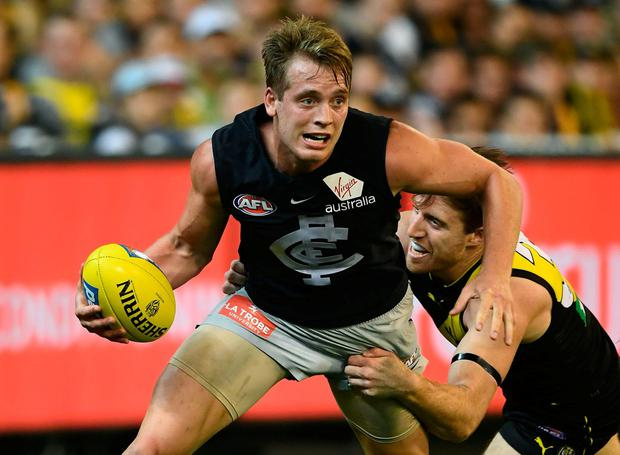 Ciarán Byrne in action for the Carlton Blues against Richmond Tigers during the first game of the 2018 AFL season at the Melbourne Cricket Ground in front of 90,000 spectators. Photo: Quinn Rooney/Getty Images