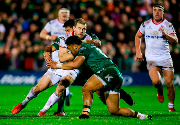 Will Addison of Ulster is tackled by Jarrad Butler, behind, and Bundee Aki of Connacht. Photo by John Dickson/Sportsfile