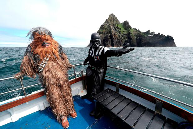 Fans dressed as Chewbacca and Darth Vader approach Skellig Michael. Picture: PA