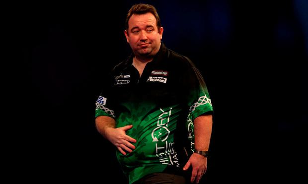 Brendan Dolan reacting during day fourteen of the William Hill World Darts Championships at Alexandra Palace