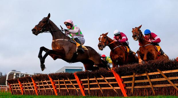 Sharjah, with Patrick Mullins up, left, jump the last ahead of Samcro, with Jack Kennedy up, centre, and Tombstone, with Davy Russell up, on their way to winning the Ryanair Hurdle during day four of the Leopardstown Festival at Leopardstown Racecourse in Dublin. Photo by David Fitzgerald/Sportsfile