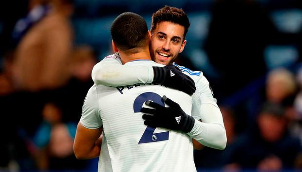 Cardiff City's Victor Camarasa (right) celebrates scoring his side'swinner with team-mate Lee Peltier (left) during the Premier League match at the King Power Stadium, Leicester.