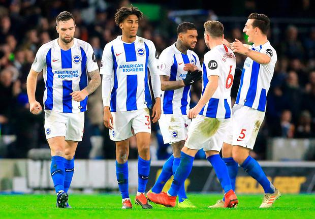 Brighton & Hove Albion's Jurgen Locadia (centre) celebrates scoring his side's first goal of the game with team-mates during the Premier League match at the AMEX Stadium, Brighton.