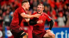 Keith Earls of Munster, right, celebrates with team-mate Andrew Conway after scoring his side's second try during the Guinness PRO14 Round 12 match between Munster and Leinster at Thomond Park in Limerick. Photo by Diarmuid Greene/Sportsfile