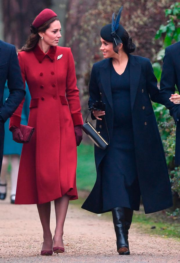 TOGETHER: Duchesses Meghan and Kate attend church at Sandringham on Christmas Day. Photo: Joe Gidden/PA