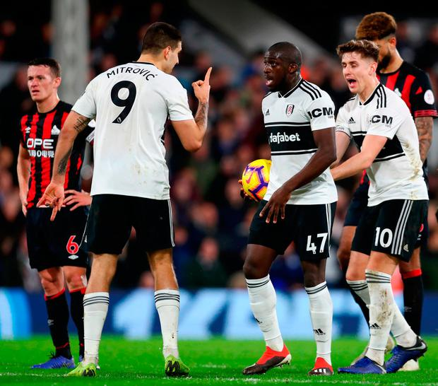 Aboubakar Kamara of Fulham argues with Aleksandar Mitrovic of Fulham over who will take the penalty ahead of Aboubakar Kamara of Fulham taking the penalty and missing. Photo: Clive Rose/Getty Images