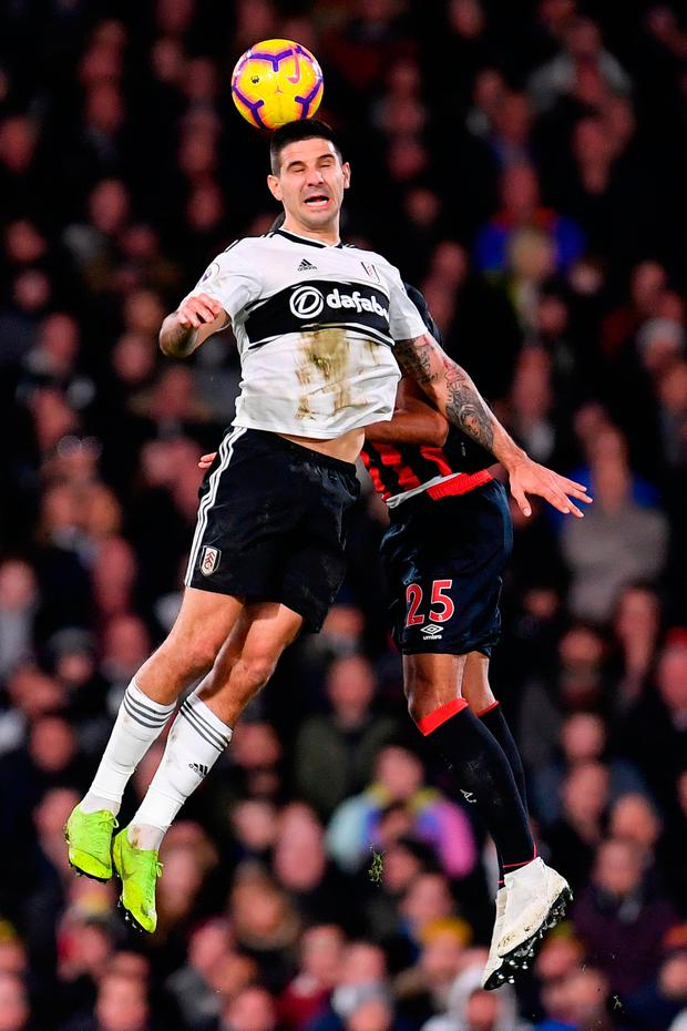 Aleksandar Mitrovic of Fulham battles for possession with in the air with Mathias Zanka Jorgensen of Huddersfield Town. Photo: Getty