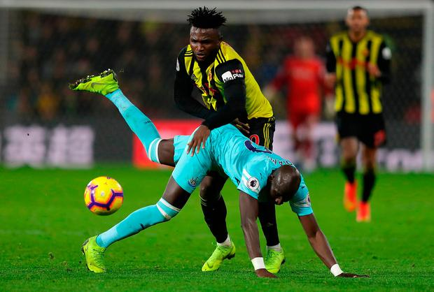 Isaac Success of Watford shakes off a tackle by Mohamed Diame of Newcastle United. Photo: Getty
