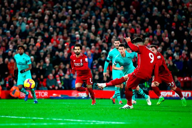 Roberto Firmino of Liverpool scores his sides fifth goal. Photo: Getty