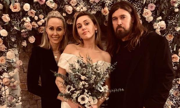 Miley Cyrus with parents Tish and Billy Ray at her secret pre-Christmas wedding. Picture: Instagram