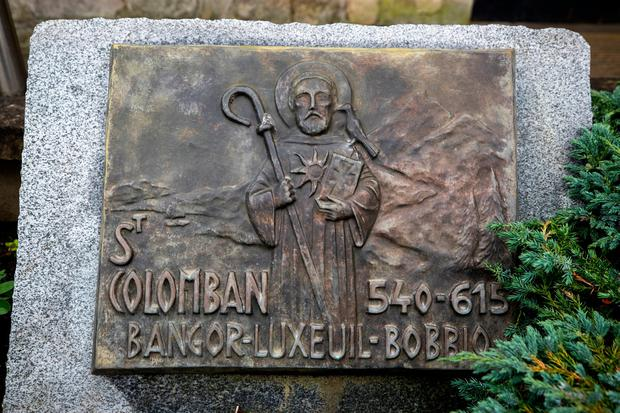 A stone with a bronze cast dedicated to Saint Columbanus which sits at the entrance to Bangor Abbey in Bangor, Northern Ireland. Photo: Liam McBurney/PA Wire