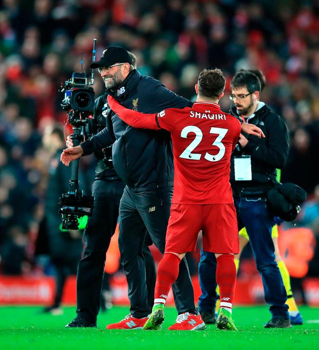 Liverpool manager Jurgen Klopp (left) celebrates after the game with Xherdan Shaqiri