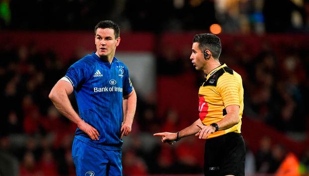 Referee Frank Murphy speaks with Jonathan Sexton of Leinster during clash with Munster