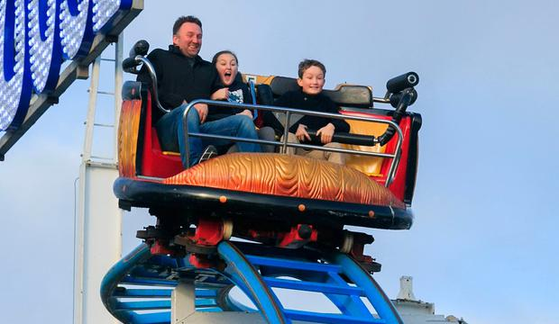 Let the good times roll: Joe, Eloise and Nano Creighton from Kildare enjoying Funderland at the RDS, Dublin. Photo: Gareth Chaney, Collins