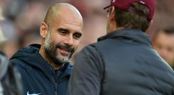 Face to face: Pep Guardiola has admitted his Manchester City team cannot afford to drop points against Jurgen Klopp's table-topping Liverpool on Thursday night. Photo: Getty Images