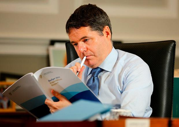 Give and take: Finance Minister Paschal Donohoe preparing the budget that changed tax and USC. Photo: Gerry Mooney