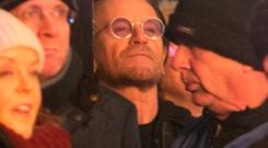 Bono watches on as his son performs