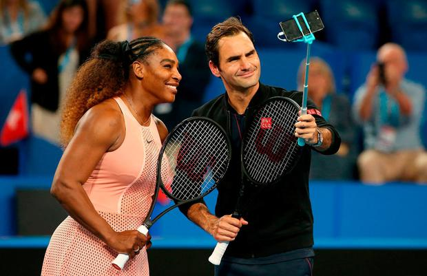 Serena Williams of the United States and Roger Federer of Switzerland take a selfie on court following their mixed doubles match during day four of the 2019 Hopman Cup at RAC Arena on January 01, 2019 in Perth, Australia. (Photo by Paul Kane/Getty Images)