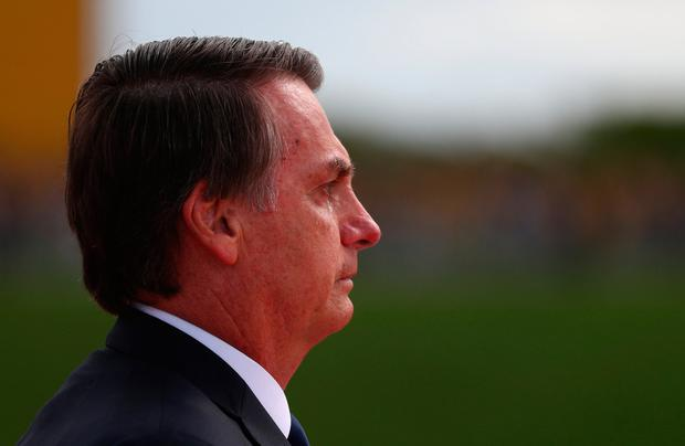 Brazil's new President Jair Bolsonaro cries after the swearing-in ceremony as he leaves Brazil's National Congress, in Brasilia, Brazil