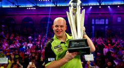 Michael van Gerwen poses with the trophy after victory in the final against Michael Smith (Photo by Jordan Mansfield/Getty Images)