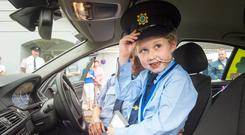 'Magical' memories: Fionn Doyle (7) in a Garda car on his birthday in August. Photo: Daragh McSweeney
