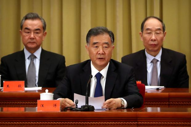 Chinese Politburo Standing Committee member Wang Yang speaks during an event to commemorate the 40th anniversary of the