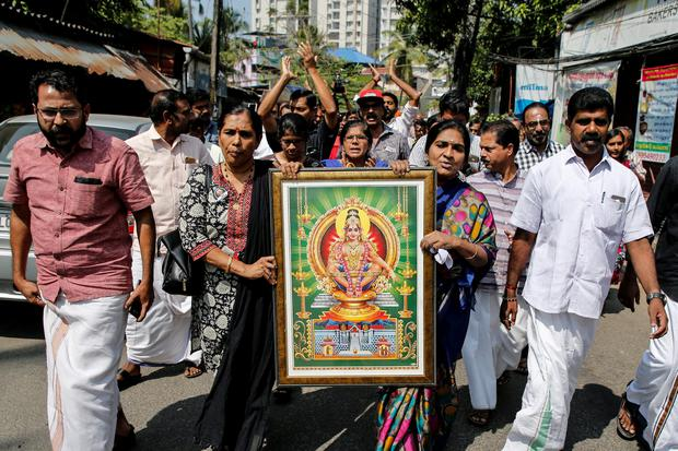 Protesters hold a portrait of Hindu deity Ayappa as they take part in a rally called by various Hindu organisations after two women entered the Sabarimala temple, in Kochi, India. Picture: Reuters