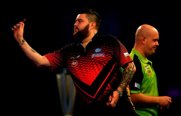 Michael Smith throws during his final defeat against Michael van Gerwen at the World Darts Championships. Photo: Steven Paston/PA Wire