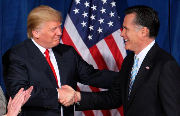 Handshake: Trump endorsed Romney during the 2012 presidential campaign. Photo: Reuters