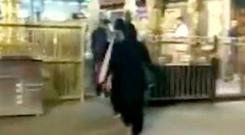 Contentious: Two Indian women enter shrine in this screengrab from a video. Photo: Reuters