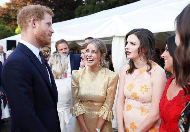 Party chat: Britain's Prince Harry with Amy Huberman and Aisling Bea at Glencairn, the British ambassador's residence