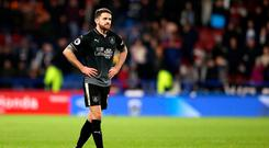 HUDDERSFIELD, ENGLAND - JANUARY 02: Robbie Brady of Burnley leaves the pitch after being shown a red card during the Premier League match between Huddersfield Town (Photo by Alex Livesey/Getty Images)