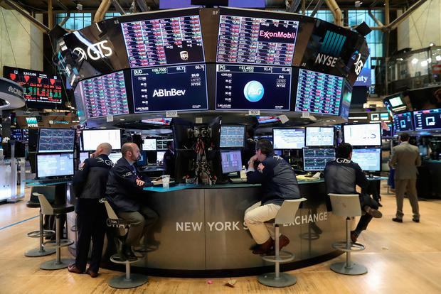 Traders look at price monitors as they work on the floor at the New York Stock Exchange (NYSE). Photo: Reuters