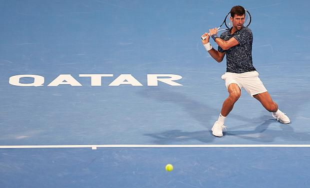 Novak Djokovic of Serbia returns a shot during the ATP Qatar ExxonMobil Open at Khalifa International Tennis and Squash Complex. (Photo by Quality Sport Images/Getty Images)