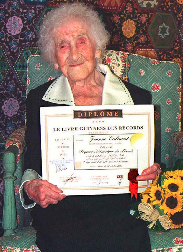 Jeanne Calment poses with a certificate from the Guiness Book of Records stating that she has passed the absolute world record with her 120 years and 239 days (Photo by Georges GOBET / AFP)GEORGES GOBET/AFP/Getty Images
