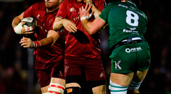 Andrew Conway of Munster concedes a penalty for crossing in front of team-mate Jean Kleyn under pressure from Eoghan Masterson of Connacht
