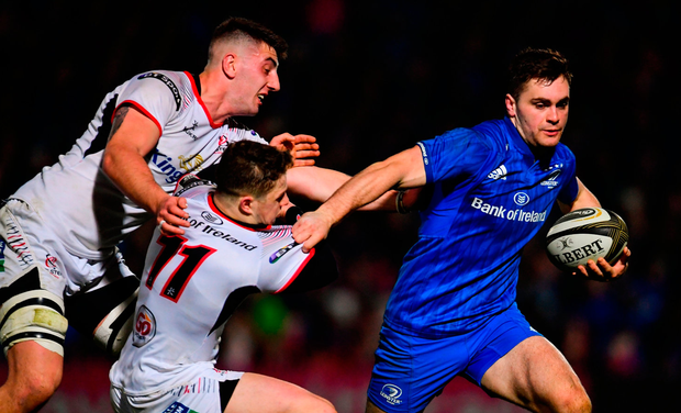 Conor O'Brien of Leinster is tackled by Matthew Dalton, left, and Angus Kernohan of Ulster on his way to scoring his side's third try. Photo: Ramsey Cardy/Sportsfile